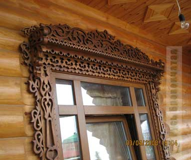 Carved platbands in the wooden house