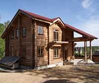 Деревянный дом из лиственницы на мху