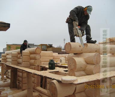 our masters of handcrafted log home building at work - Home Building Tools
